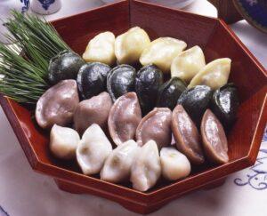 White, Purple, Black and Yellow Half-Moon Rice Cakes, or Songpyeon