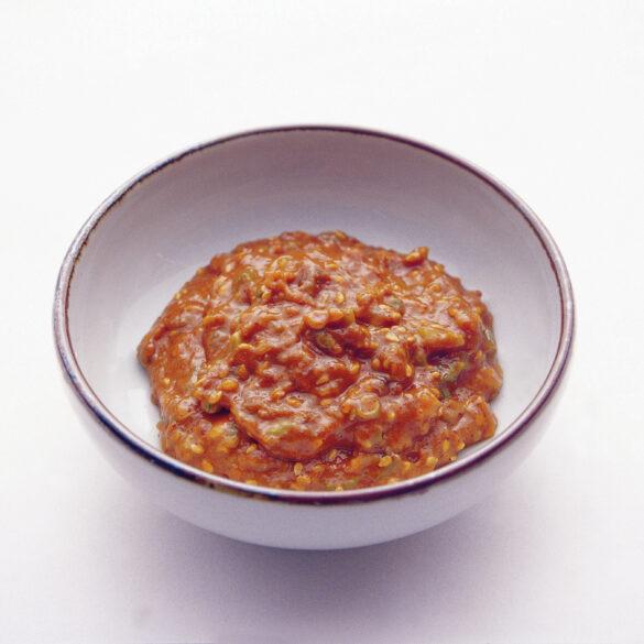 Brown Ssamjang sauce in white bowl