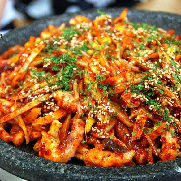 Red/Organe Octopus Stir-Fry in stone bowl, also known as Korean Nakji Bokkeum